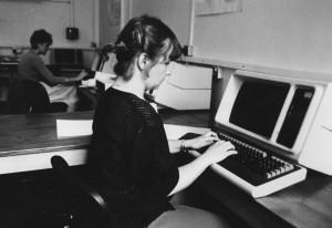 girl at ancient computer